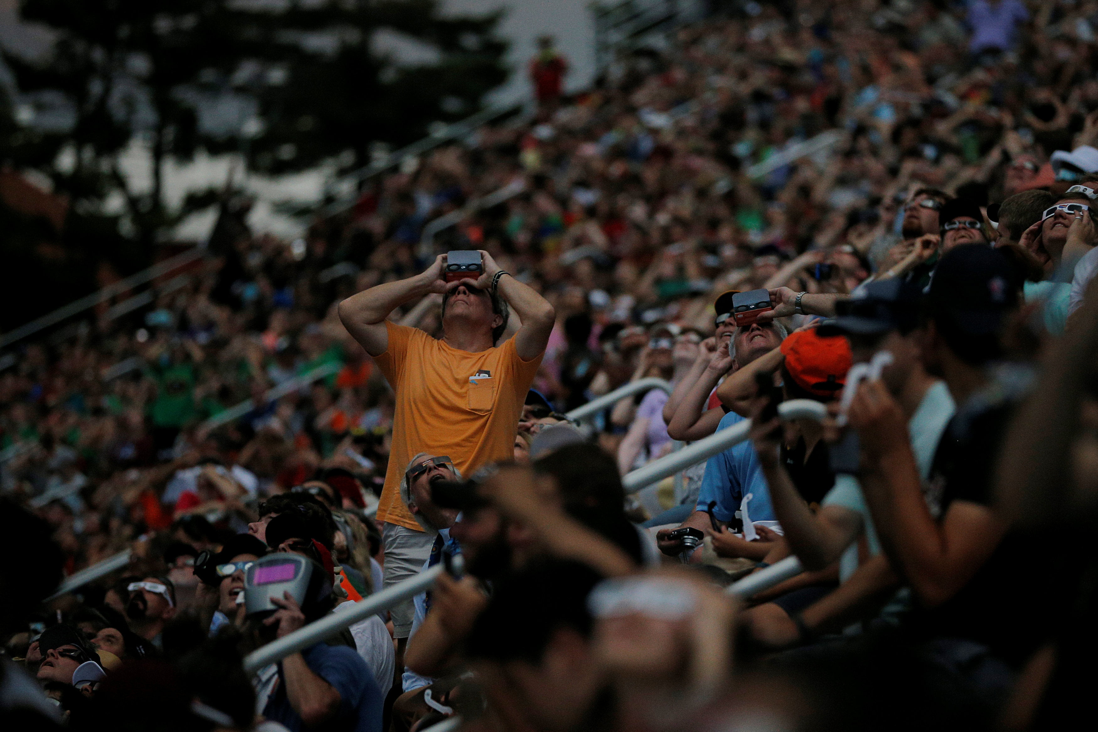 Spectators watch the final moments before the total eclipse at the football stadium at Southern Illinois University in Carbondale