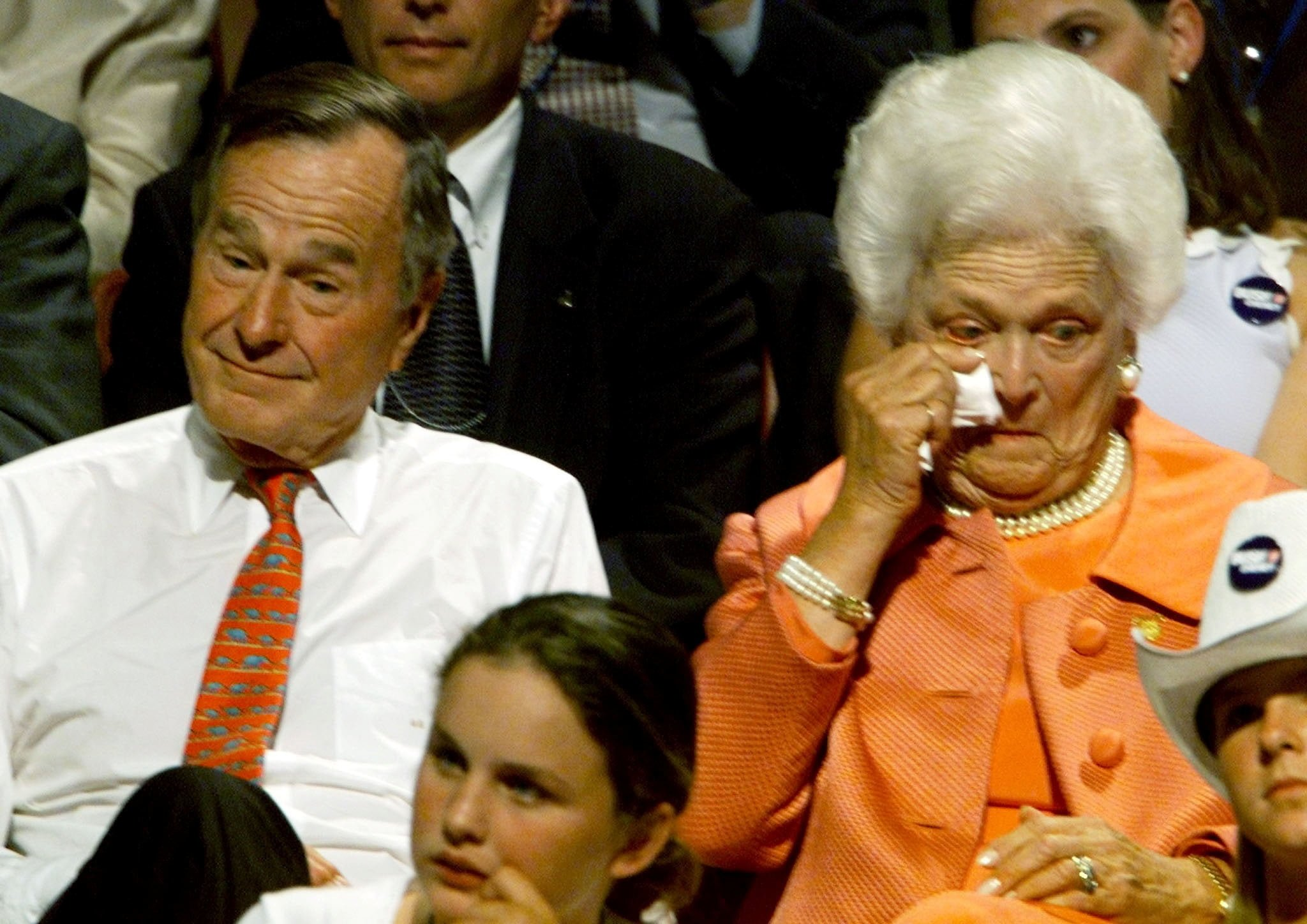 FILE PHOTO: The parents of Texas Gov. George W. Bush, former President George Bush and his wife Barbara, react as their son come out on stage to accept the presidential nomination of the Republican party in Philadelphia