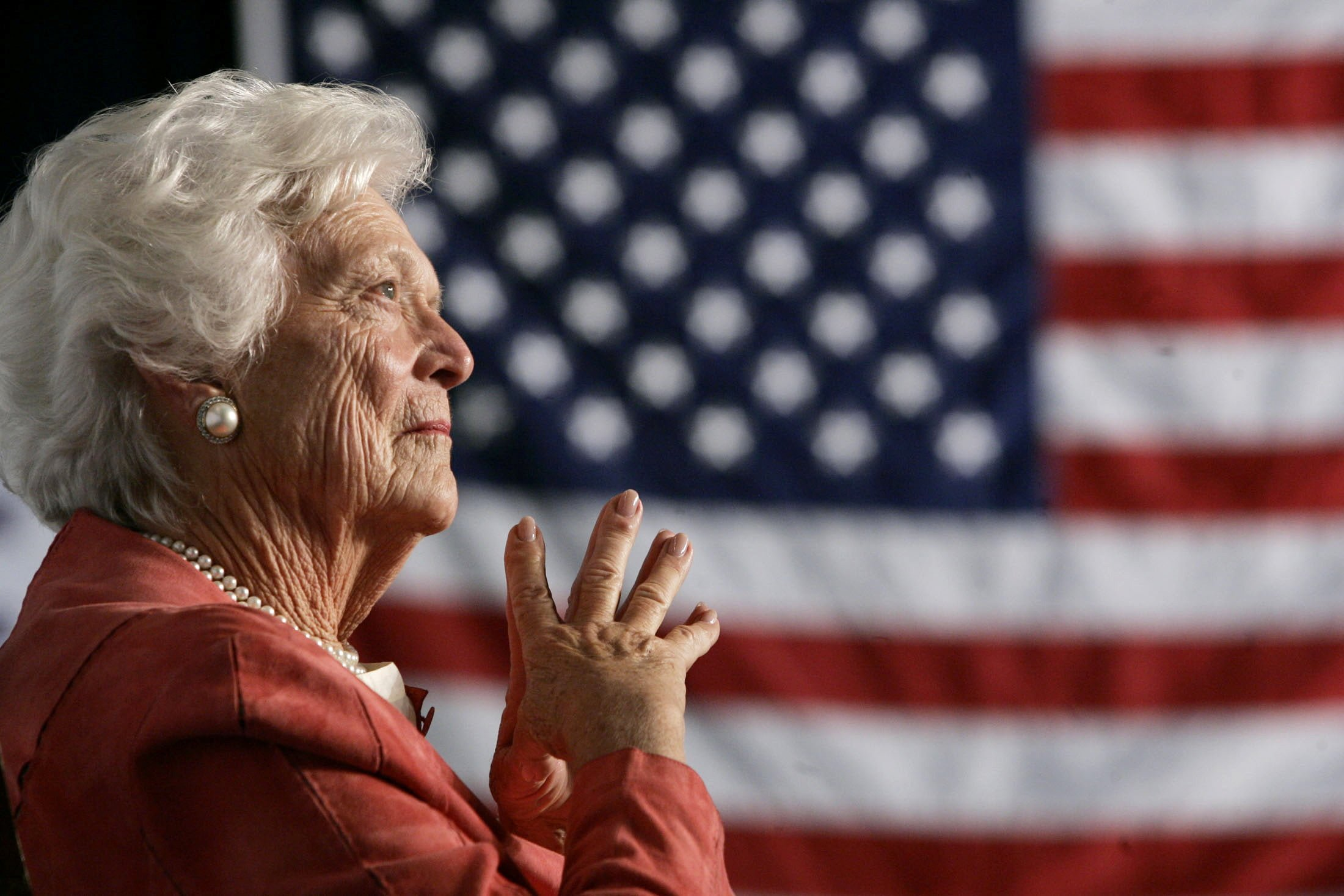 FILE PHOTO: Former U.S. first lady Barbara Bush listens to her son, President George W. Bush, as he speaks at an event on social security reform in Orlando