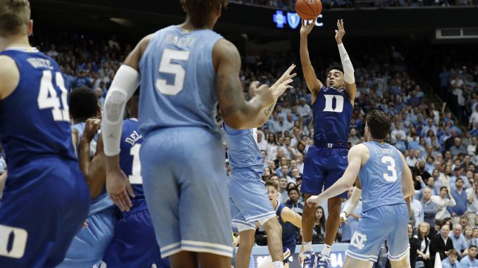 Duke's sophomore point guard, Tre Jones played well, especially down the stretch, to lift his team to a hard-fought, overtime victory over North Carolina. (Photo: Gerry Broome/The Associated Press, via the North State Journal.)