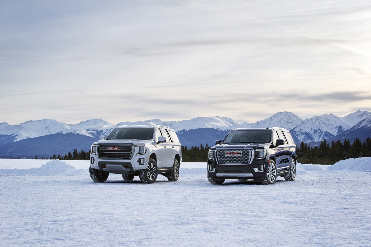 (L to R) 2021 GMC Yukon AT4 and Denali