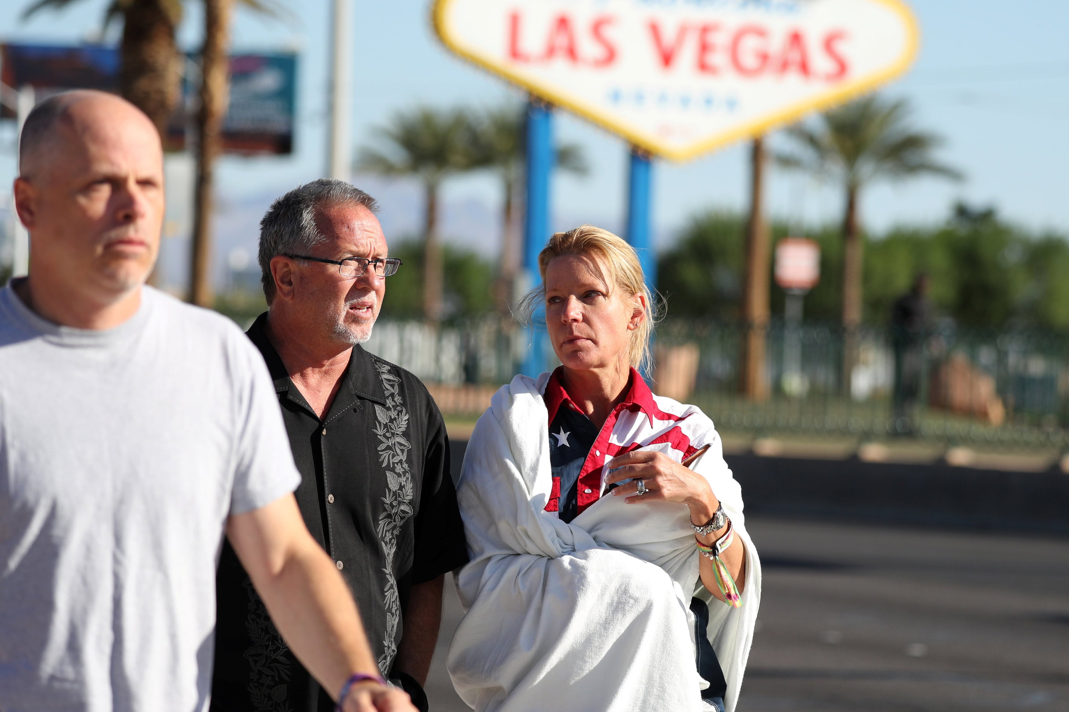 A woman wearing a Route 91 wristband walks near the Mandalay Bay Resort and Casino following a mass shooting at the Route 91 Festival in Las Vegas