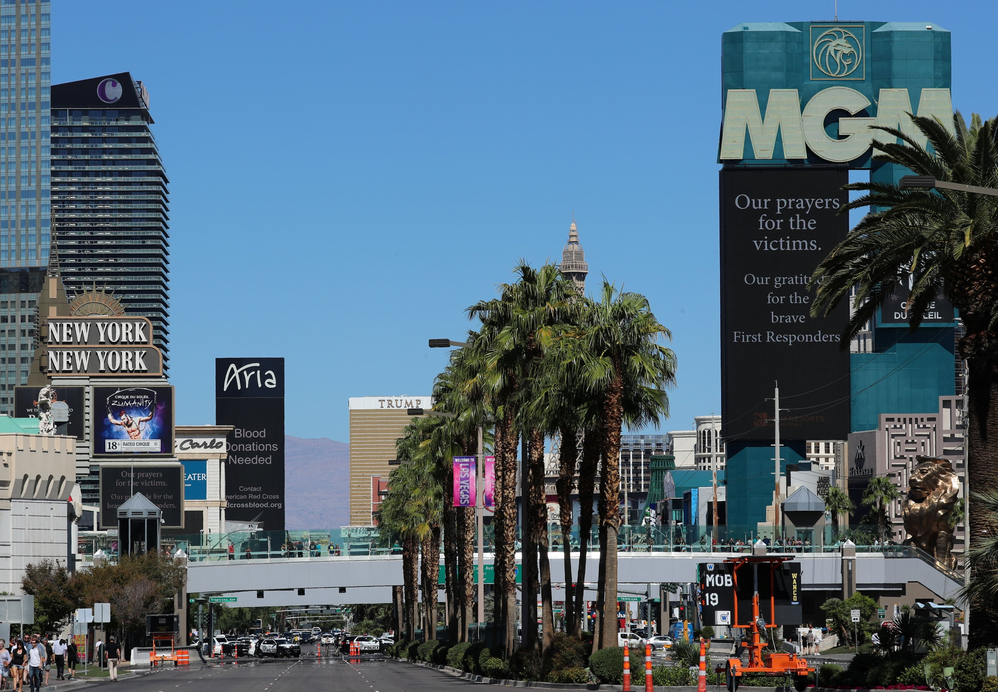 A request for blood donations and a condolences sign appears on various hotels in Las Vegas