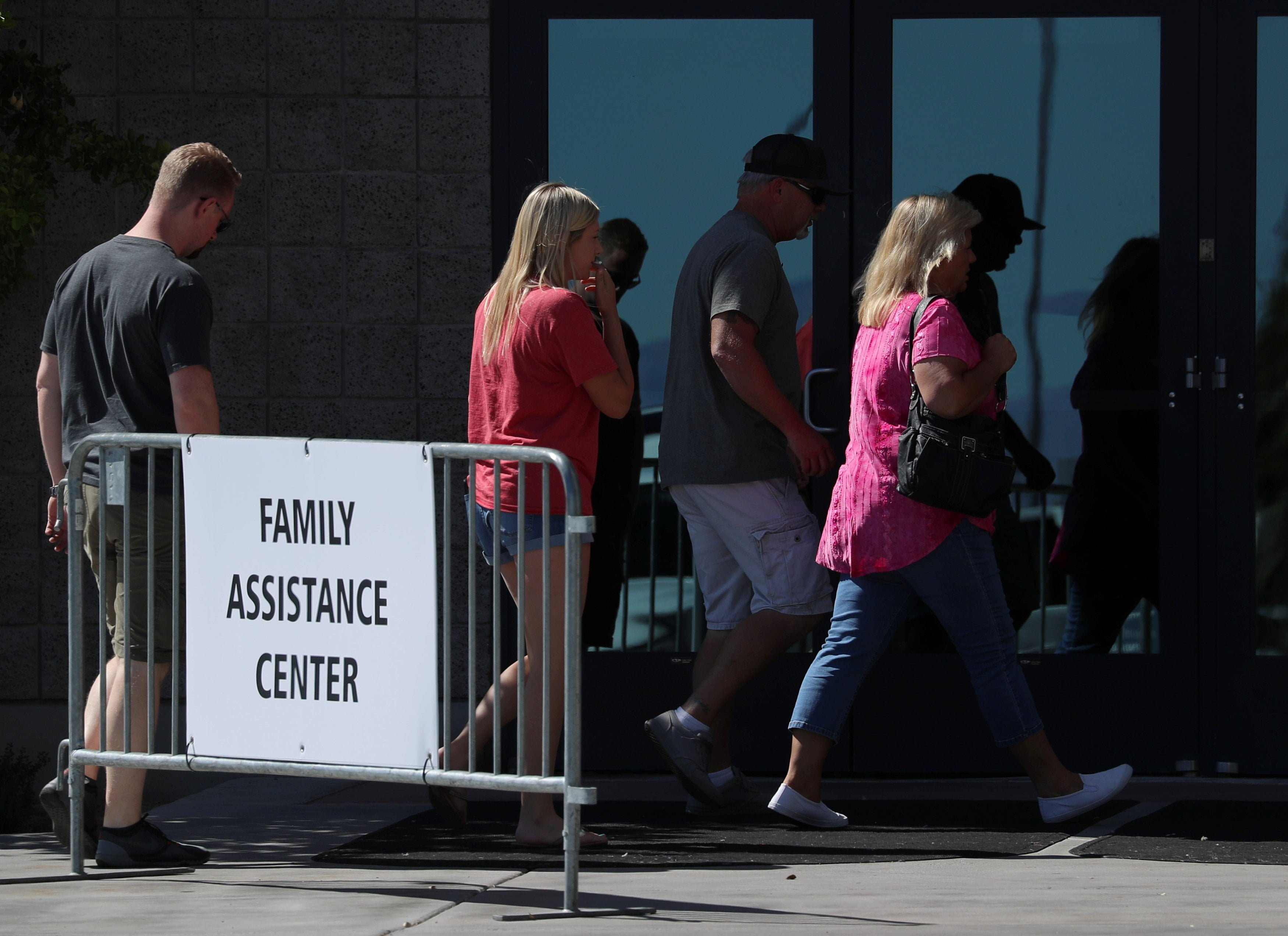 People enter the Family Assistance Center set up in the Las Vegas Convention Center in Las Vegas