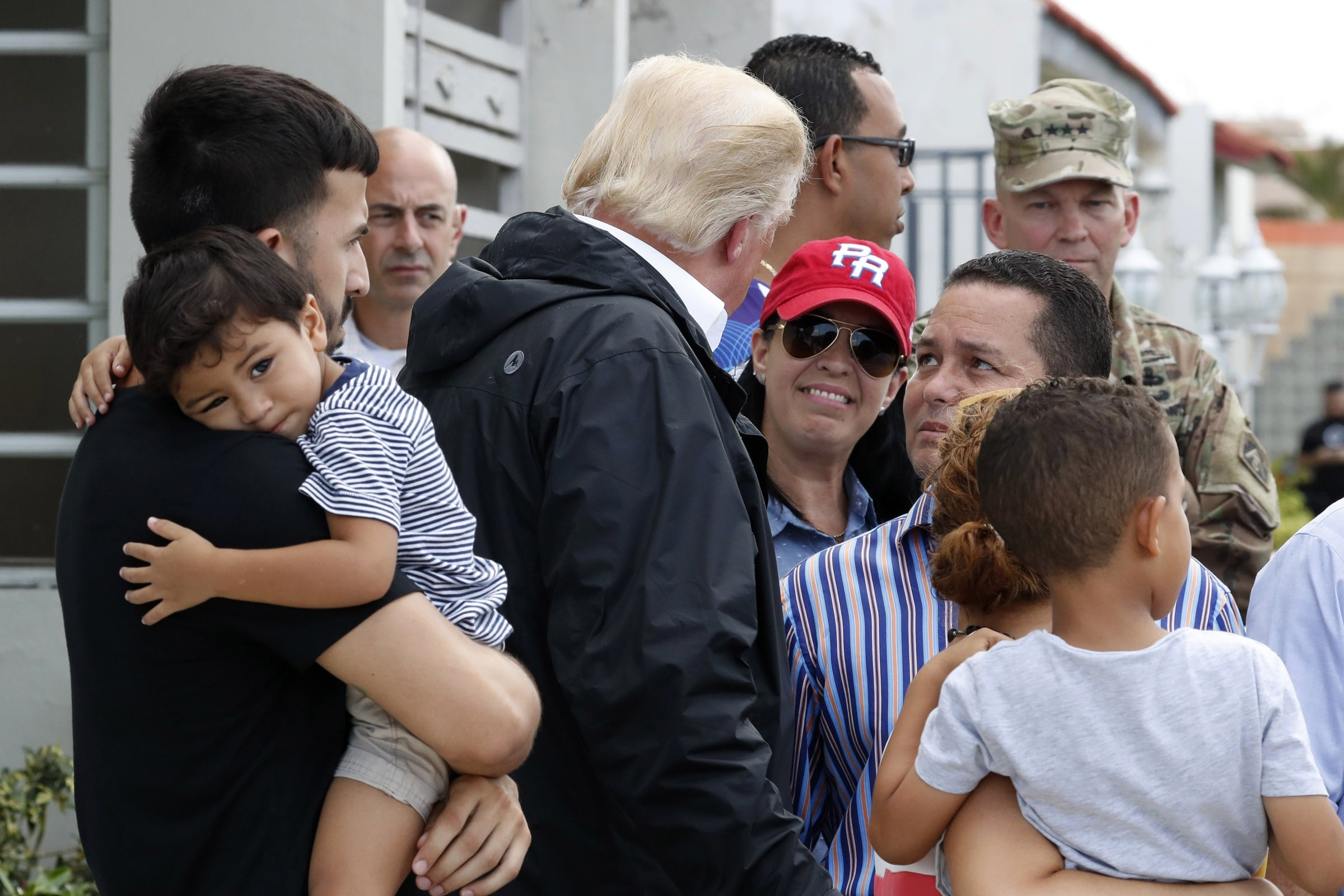 President Trump talks with residents while surveying hurricane damage in San Juan, Puerto Rico