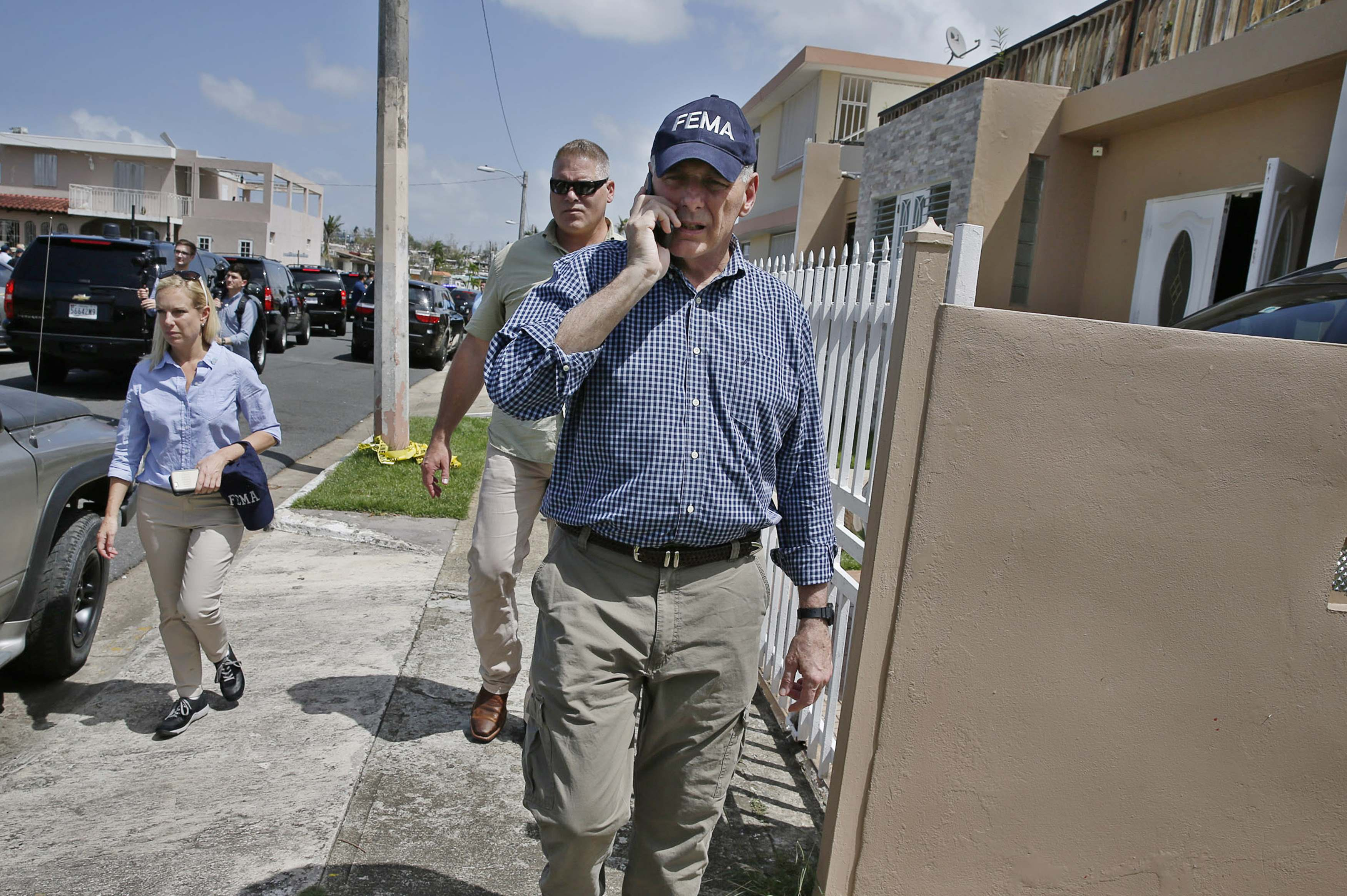 White House Chief of Staff Kelly talks on phone while visiting areas damaged by Hurricane Maria with president in Guaynabo, Puerto Rico
