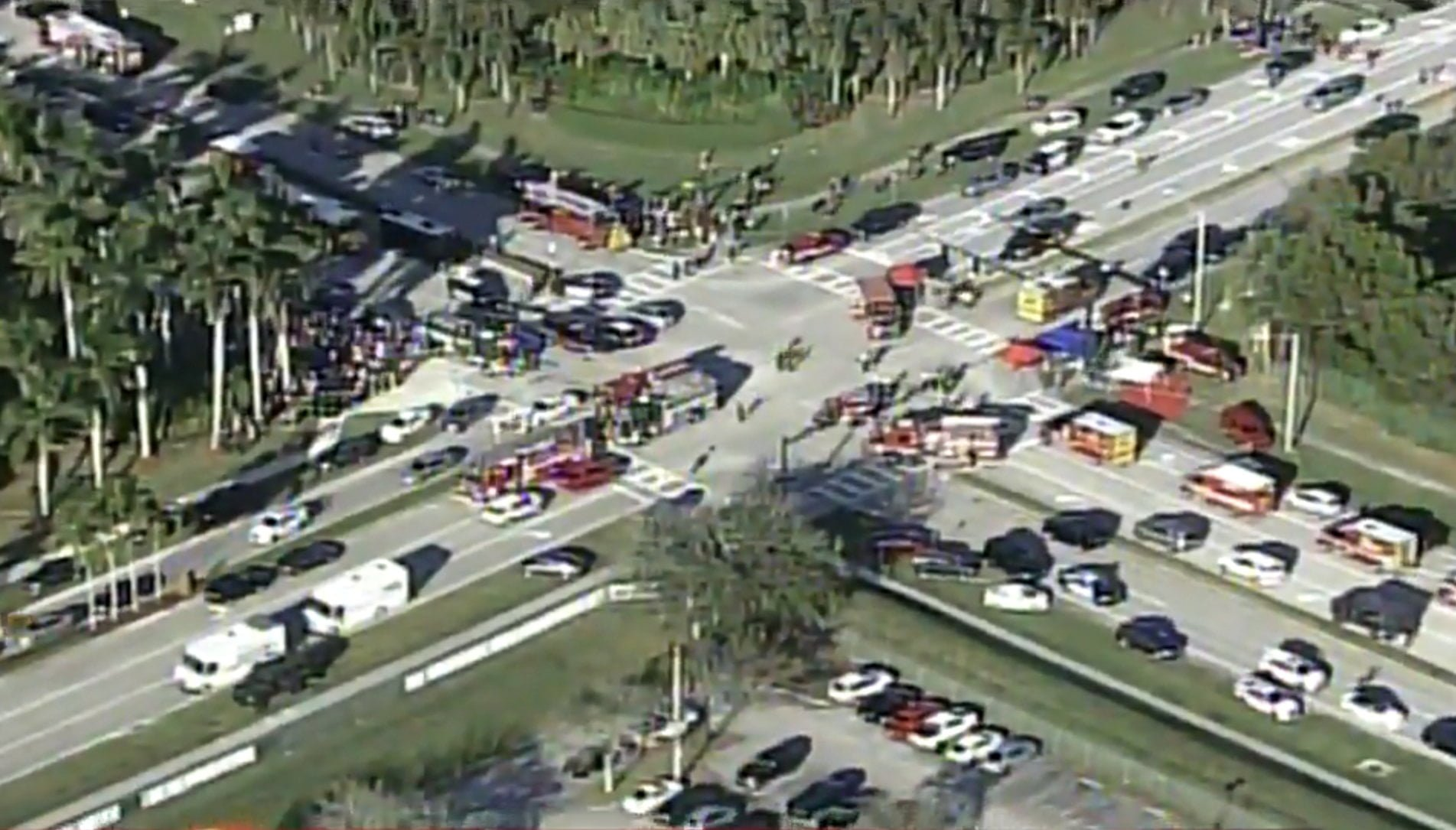 Police and rescue workers attend the scene near Marjory Stoneman Douglas High School following a shooting incident in Parkland