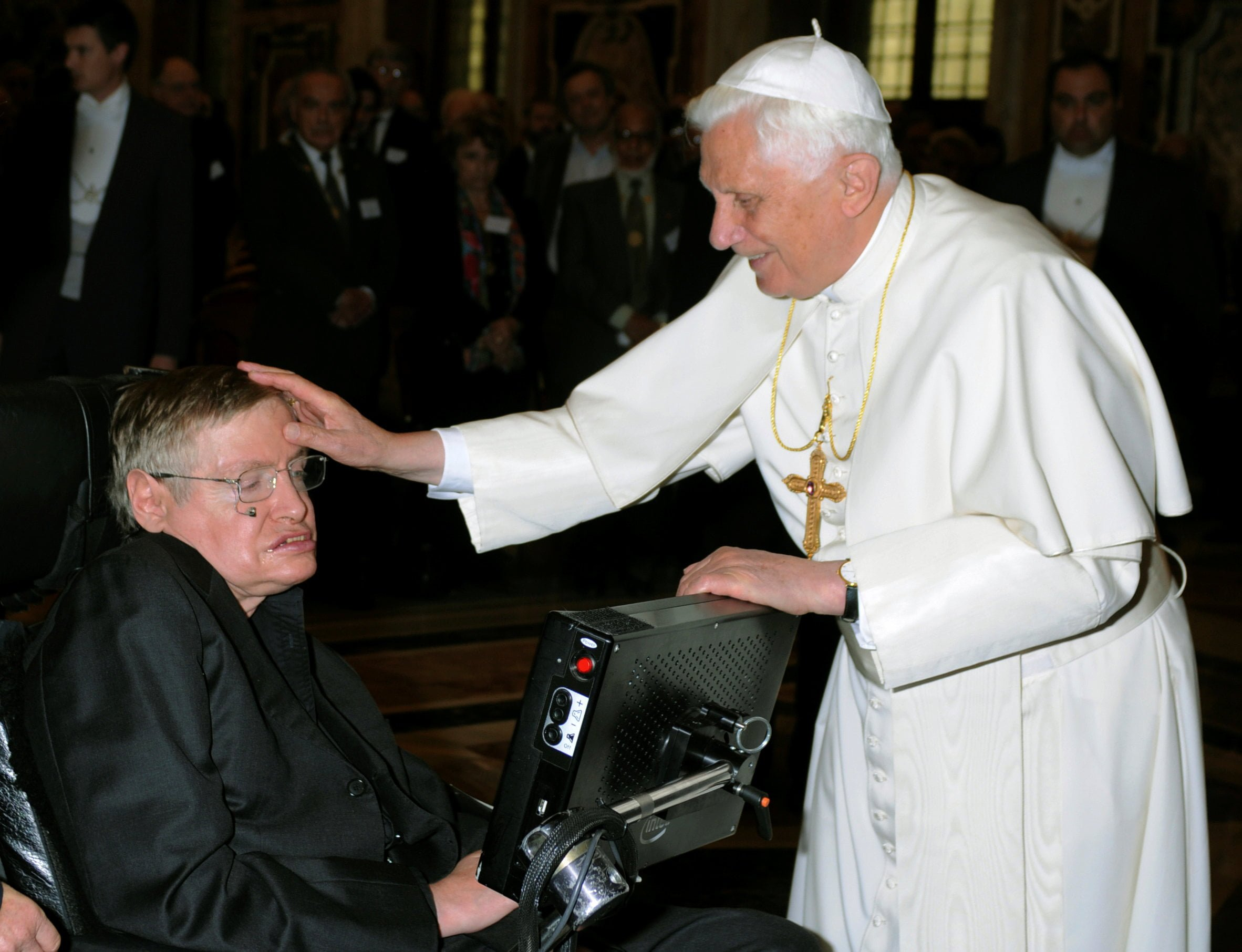 FILE PHOTO: Pope Benedict XVI greets British professor Hawking during a meeting of science academics at the Vatican