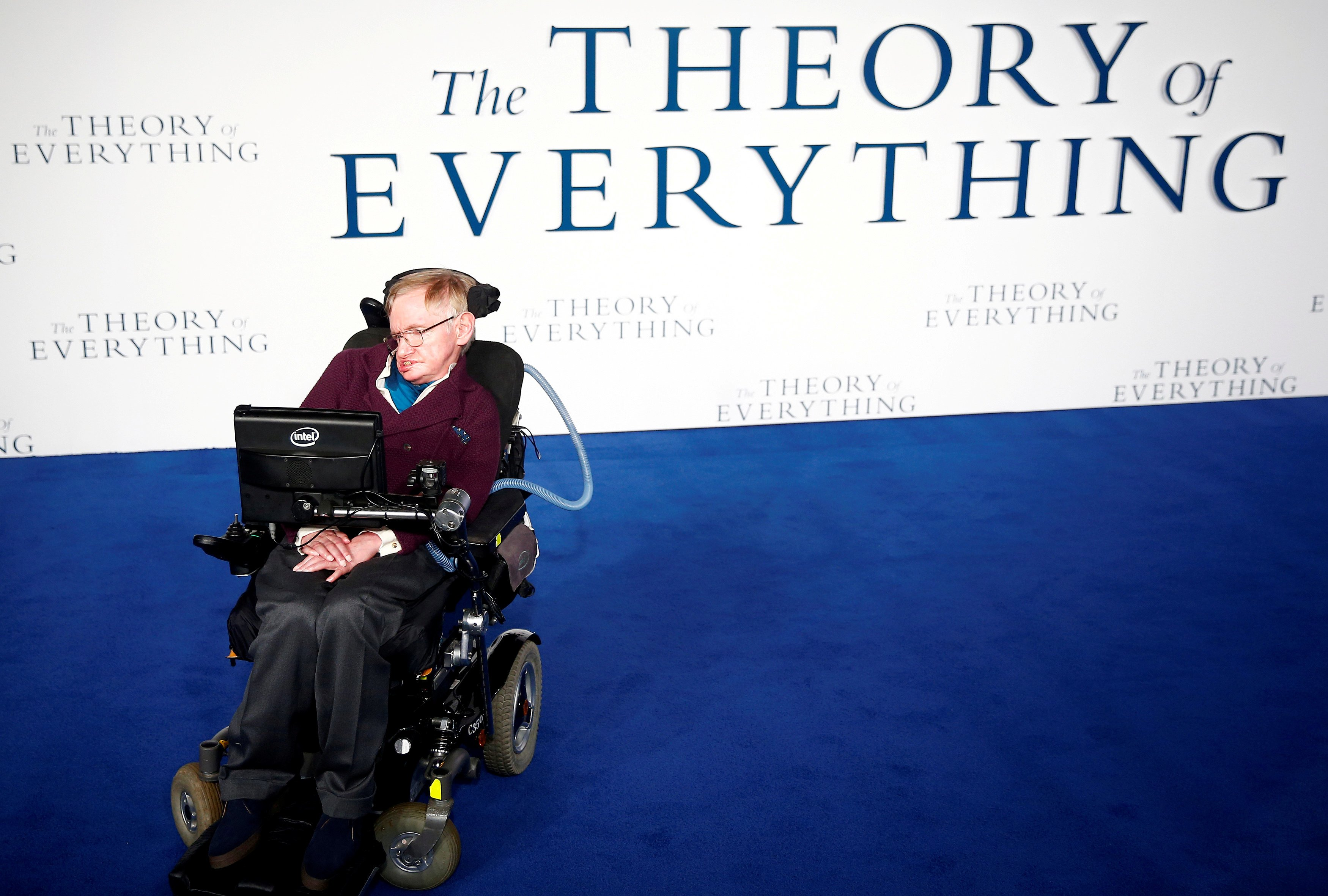 """FILE PHOTO: Stephen Hawking arrives at the UK premiere of the film """"The Theory of Everything"""" which is based around his life, at a cinema in central London"""
