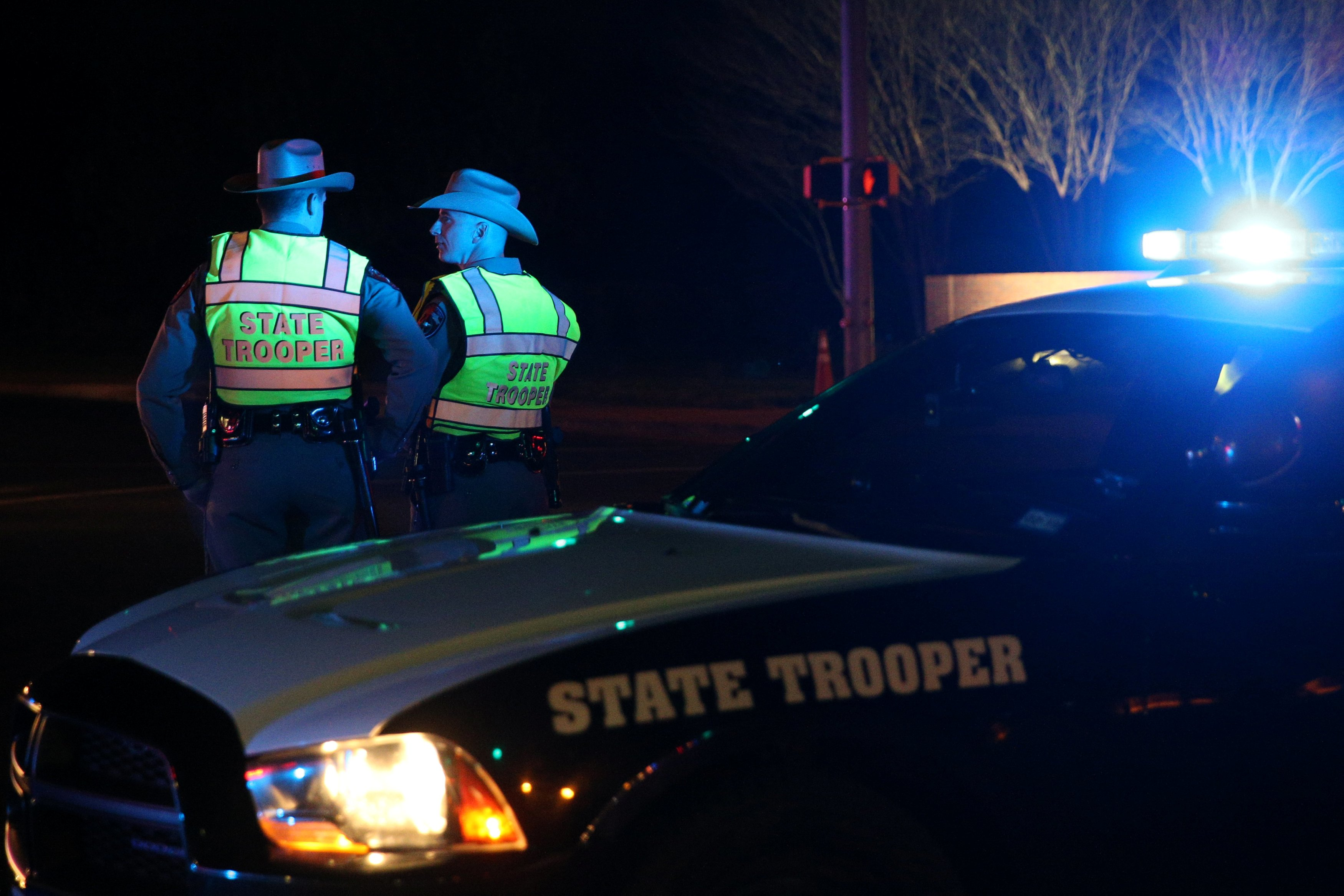 Texas state troopers keep watch at a checkpoint as nearby law enforcement personnel investigate an incident in Austin