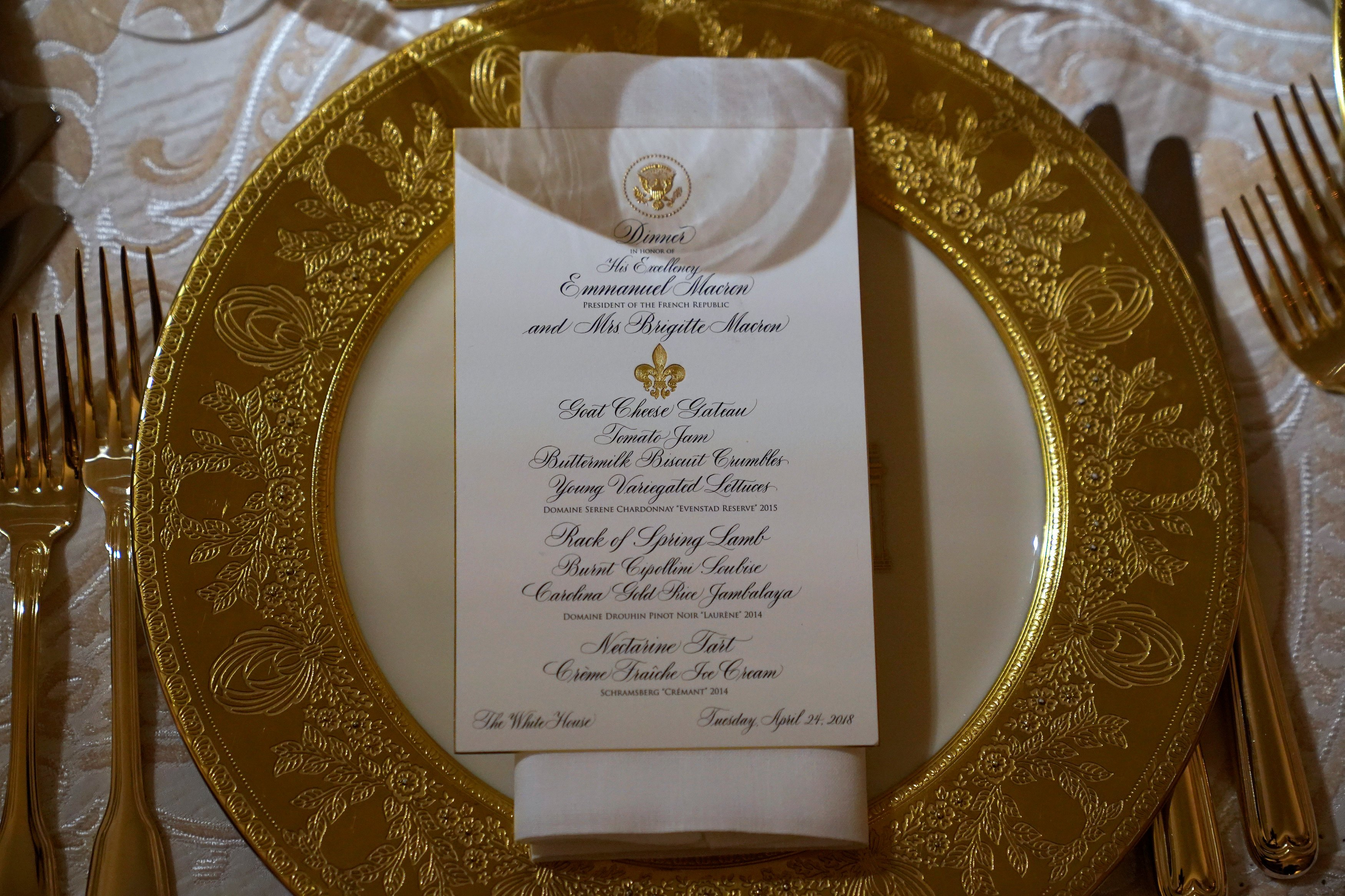A place setting for the State Dinner for French President Emmanuel Macron is shown in the State Dining Room of the White House in Washington