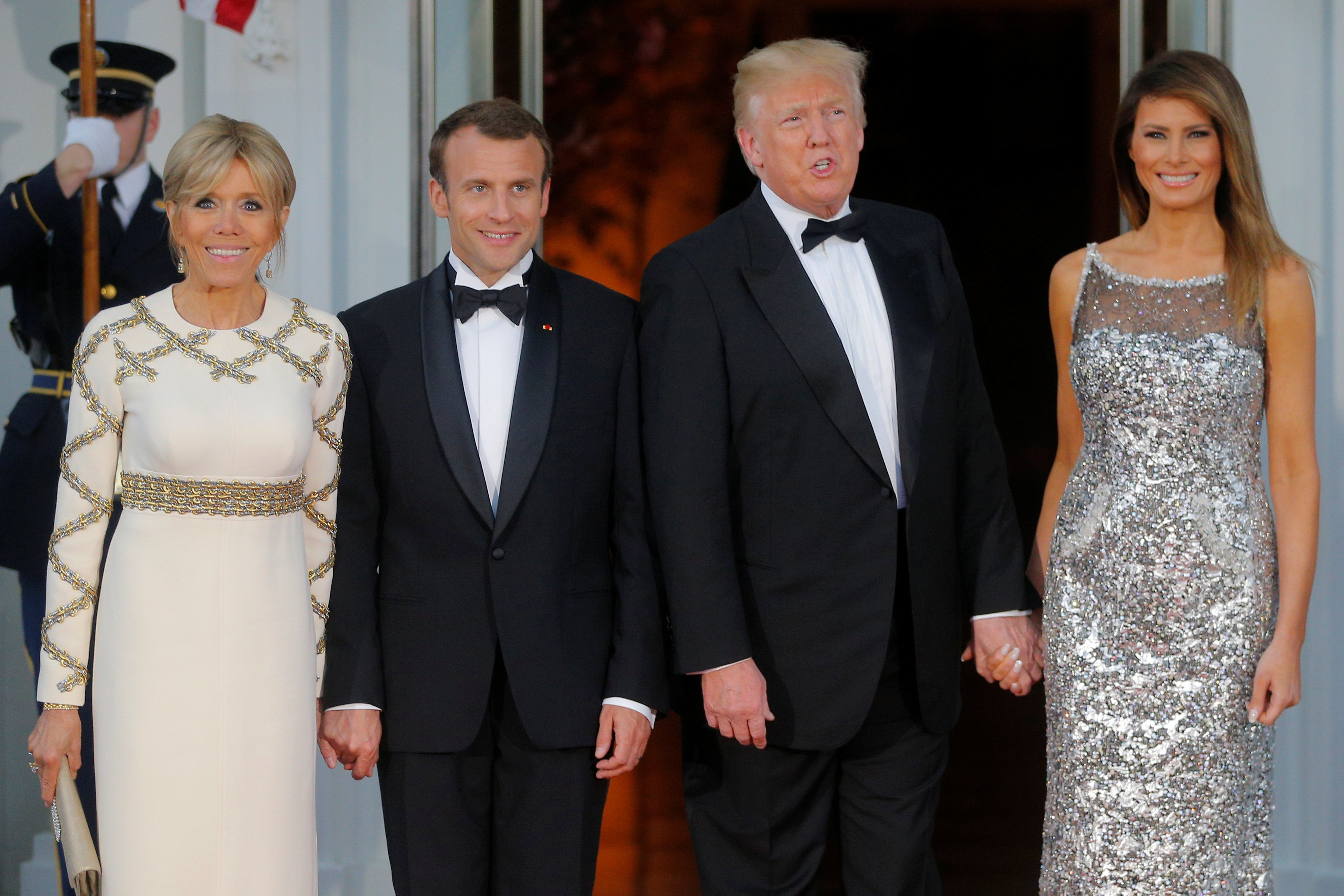 U.S. President Trump and first lady Melania welcome French President Macron and his wife for a State Dinner at the White House in Washington