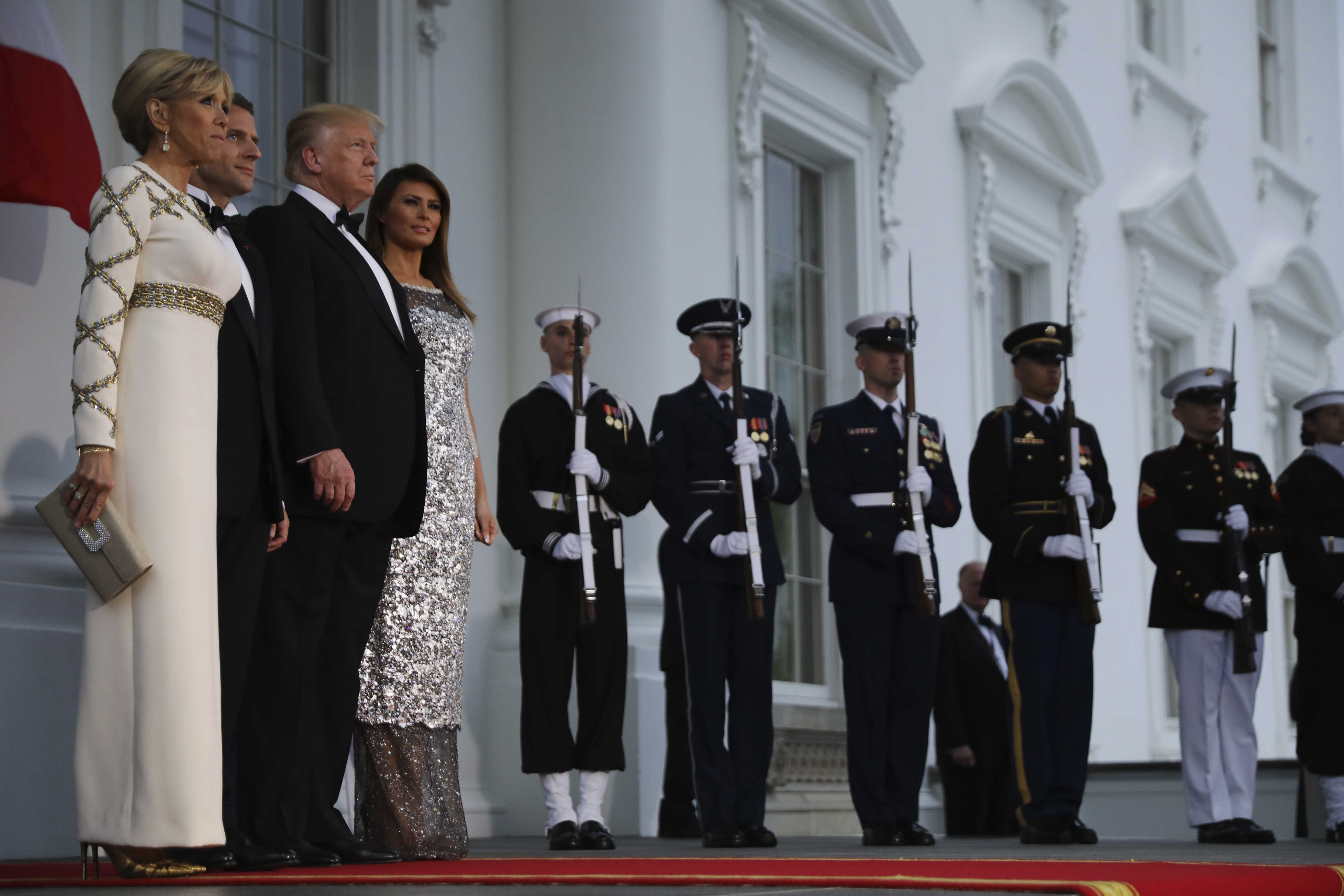 United States President Donald Trump and first lady Melania Trump welcome French President Emmanuel Macron and his wife Brigitte for a State Dinner at the White House in Washington