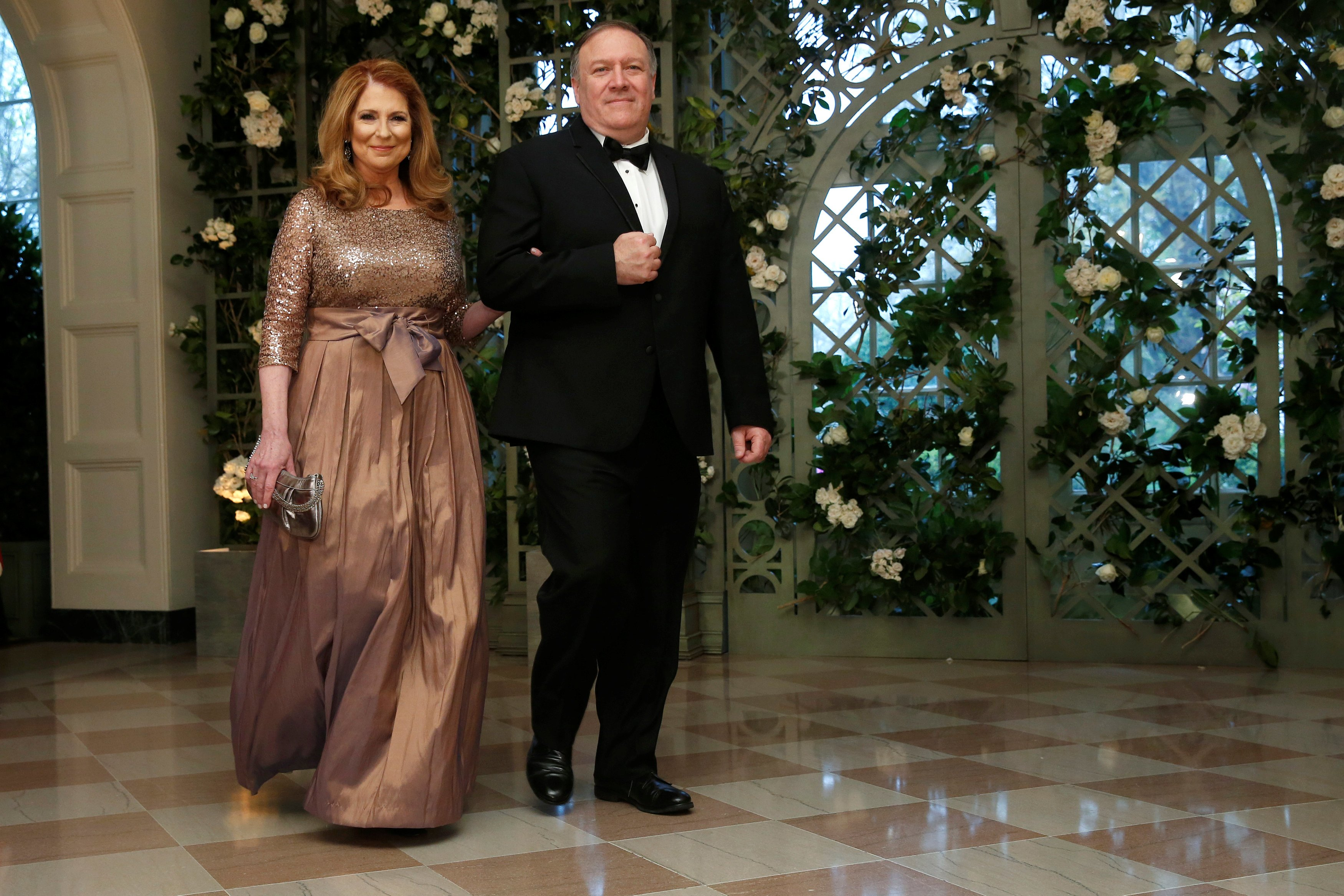 CIA Director Pompeo and his wife arrive for the State Dinner in honor of French President Macron at the White House in Washington
