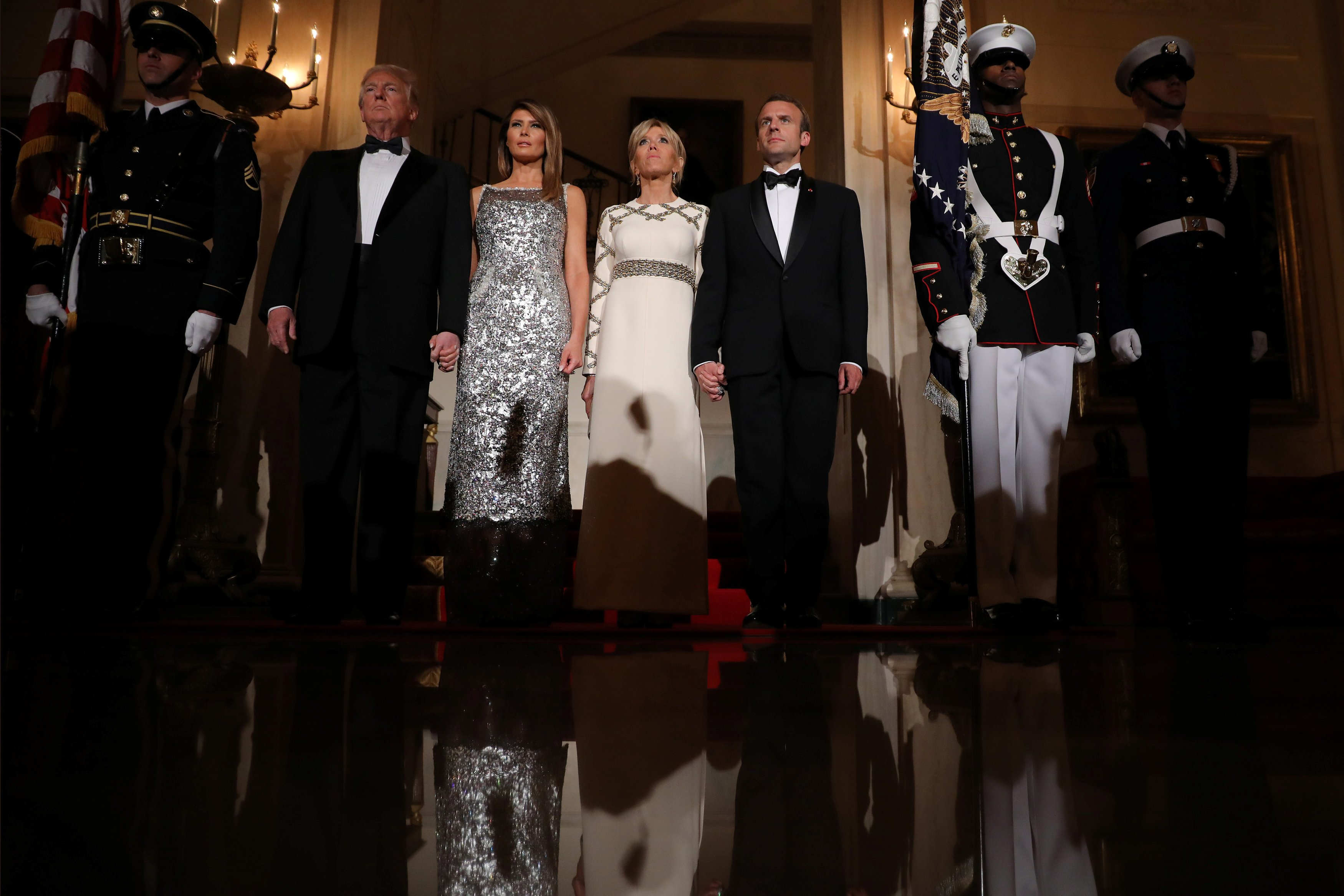 U.S. President Trump, first lady Melania, French President Macron and his wife attend a State Dinner at the White House in Washington