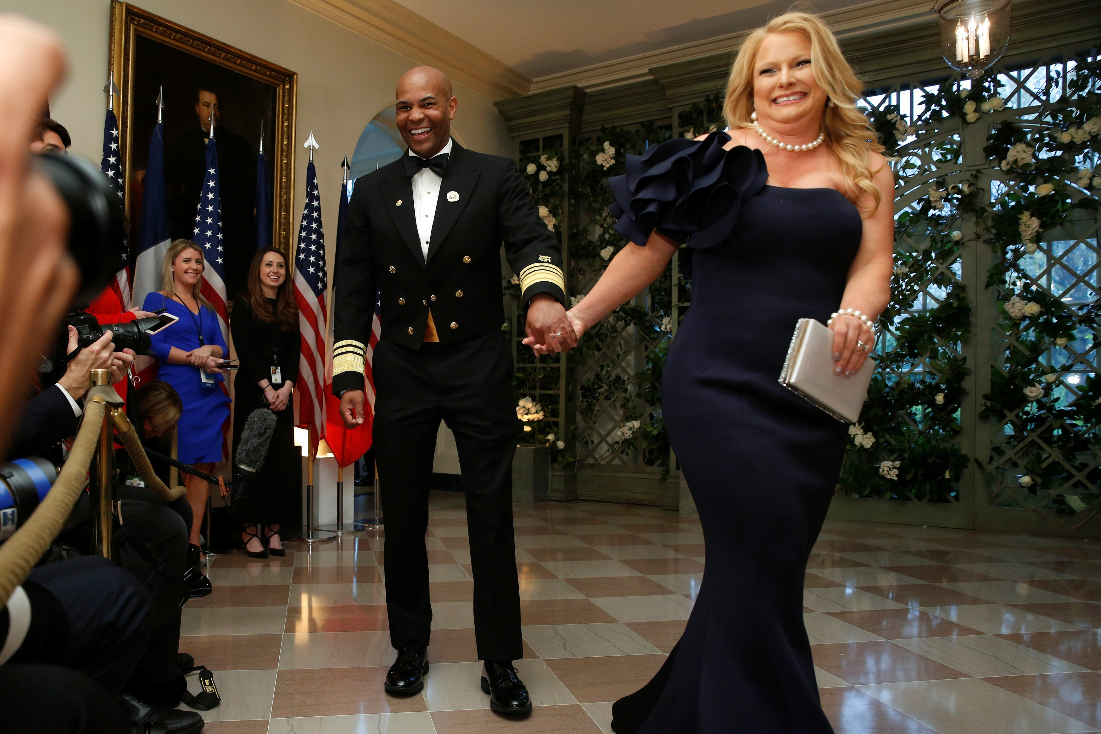 U.S. Surgeon General Adams and his wife arrive for the State Dinner in honor of French President Macron at the White House in Washington