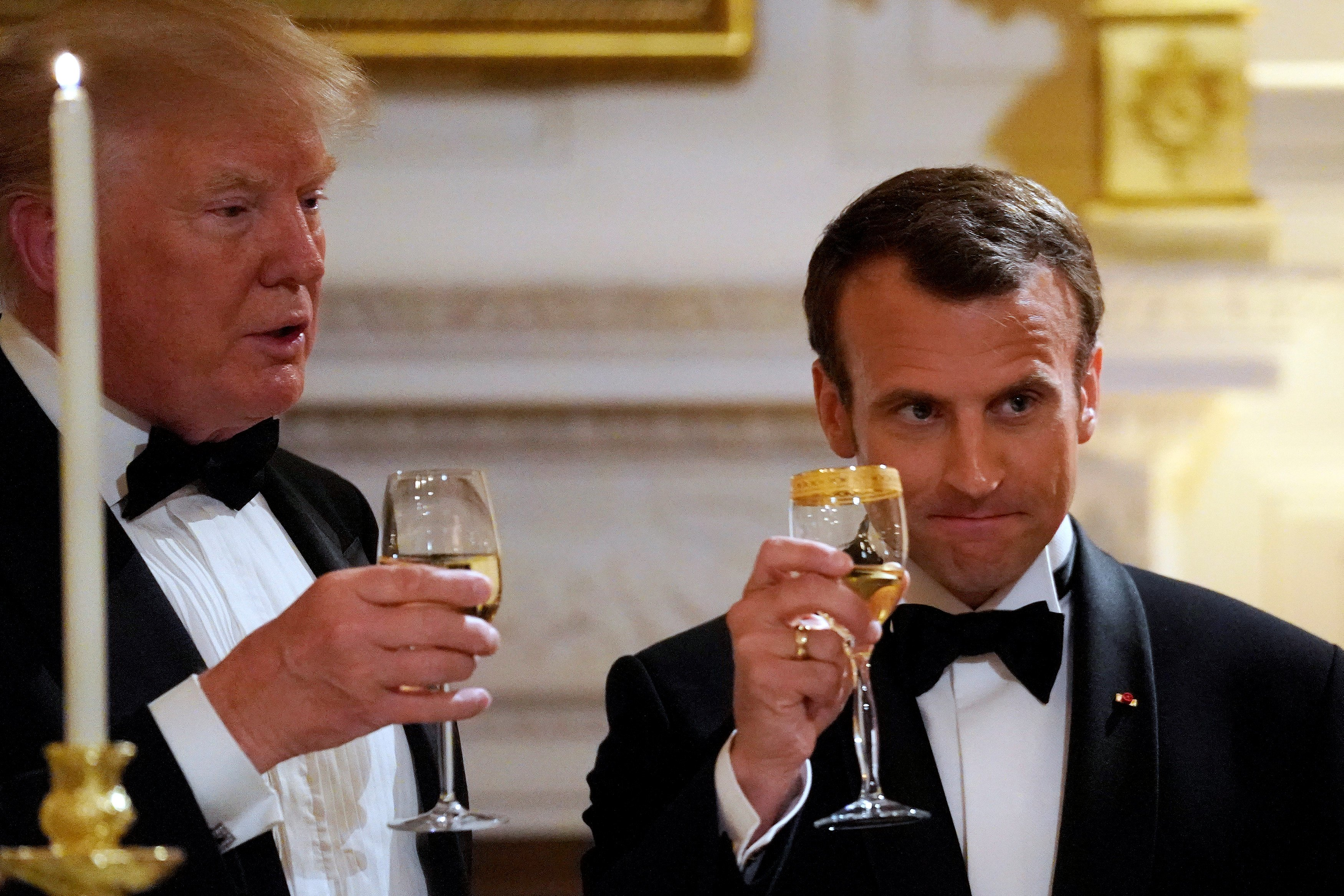 French President Emmanuel Macron toasts U.S. President Donald Trump during a State Dinner at the White House in Washington, U.S.