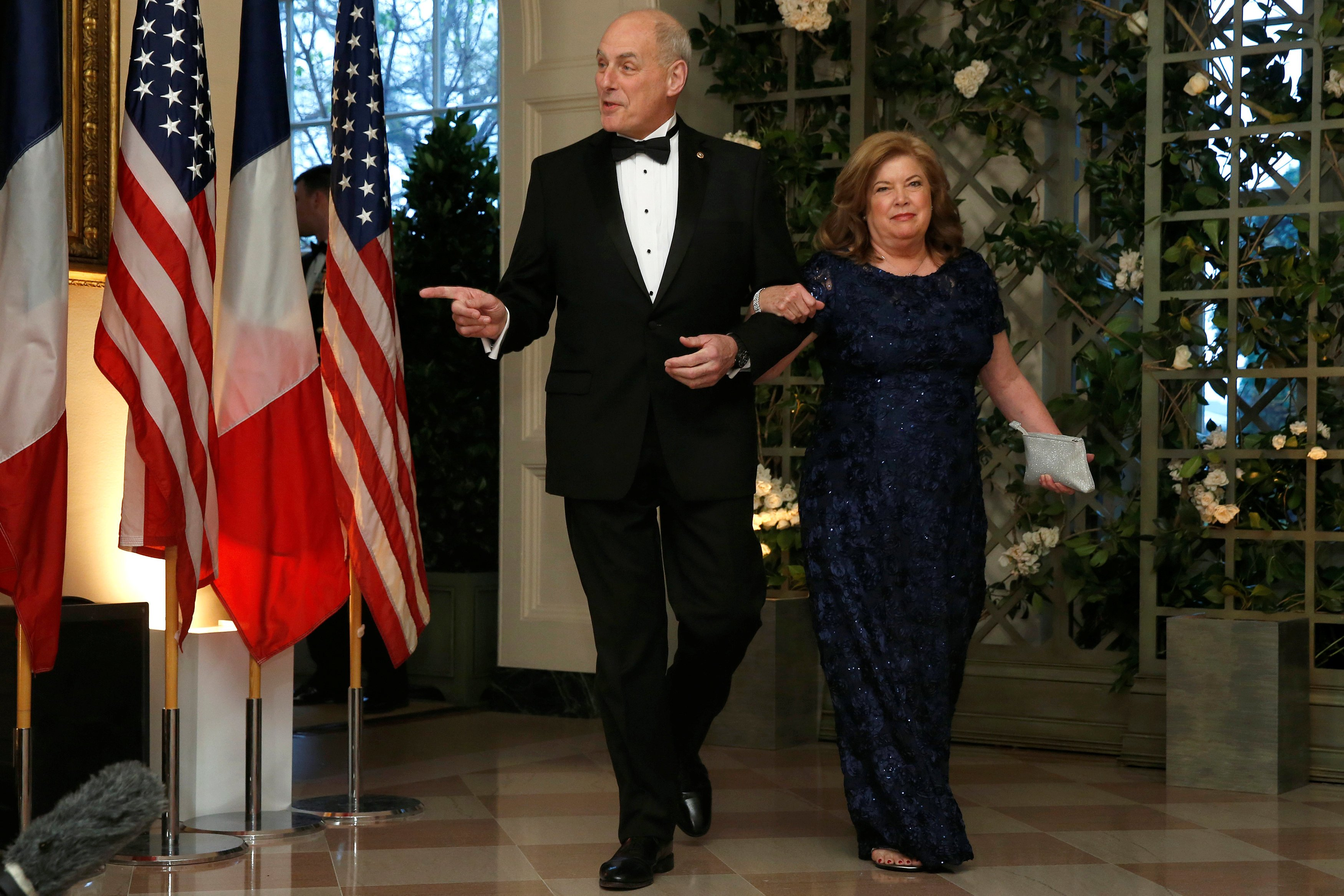 White House Chief of Staff John Kelly and his wife Karen Hernest arrive for the State Dinner in honor of French President Emmanuel Macron at the White House in Washington