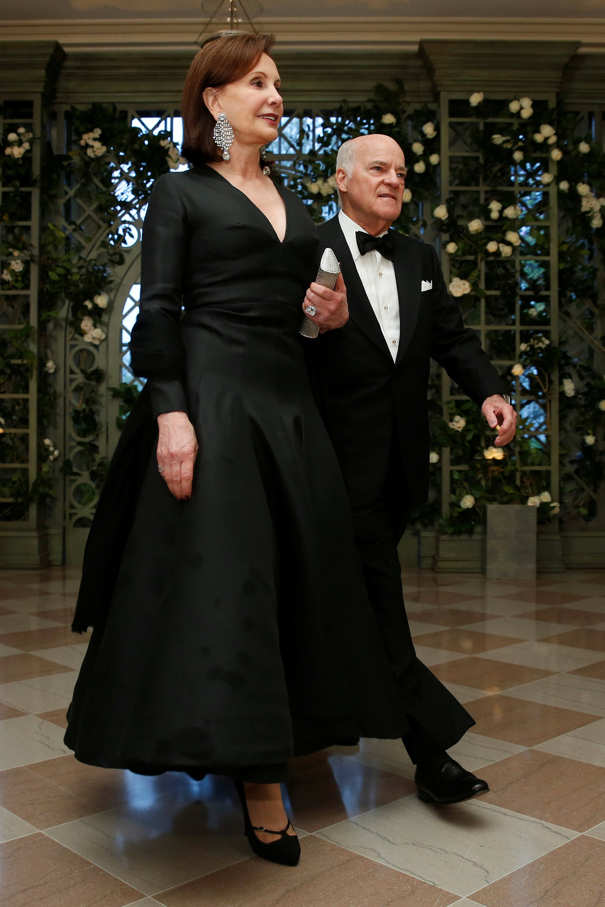 Henry Kravis, a co-founder of Kohlberg Kravis Roberts & Co. and his wife Marie-Josee Kravis arrive for the State Dinner in honor of French President Emmanuel Macron at the White House in Washington