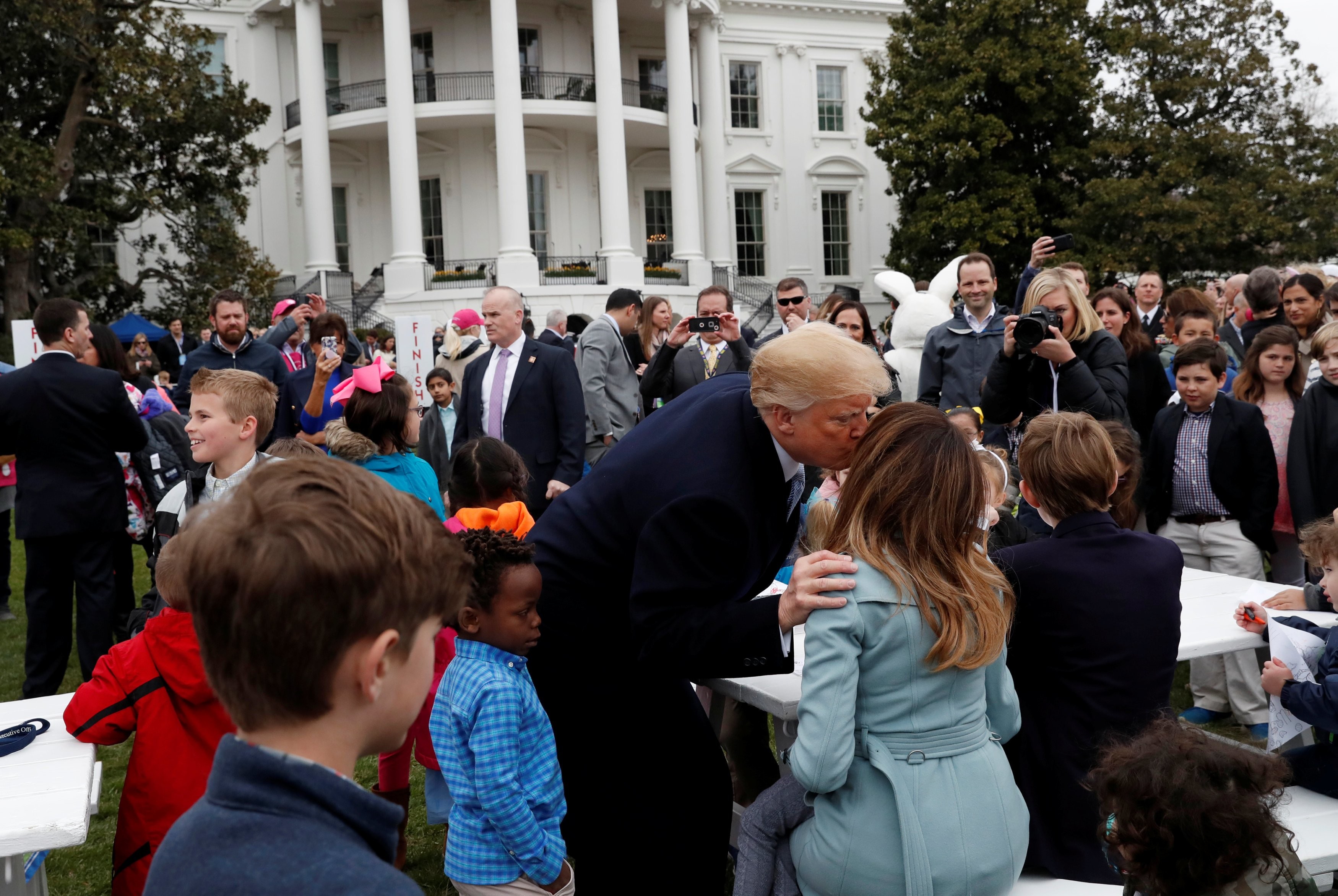 U.S. President Donald Trump gives first lady Melania Trump a kiss on the cheek during the annual White House Easter Egg Roll on the South Lawn of the White House in Washington