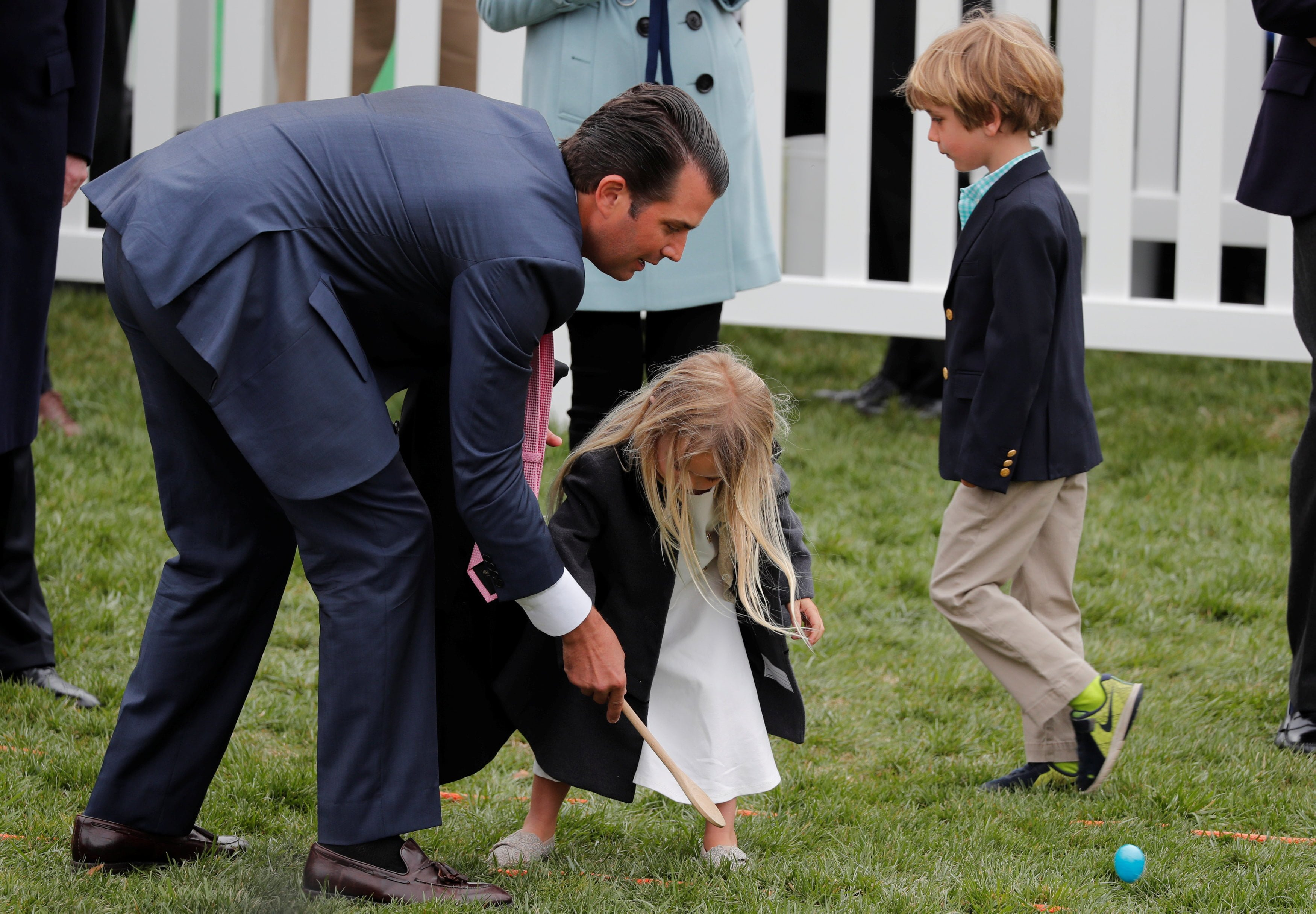 Donald Trump Jr helps his daughter Chloe roll an egg during the annual White House Easter Egg Roll on the South Lawn of the White House in Washington