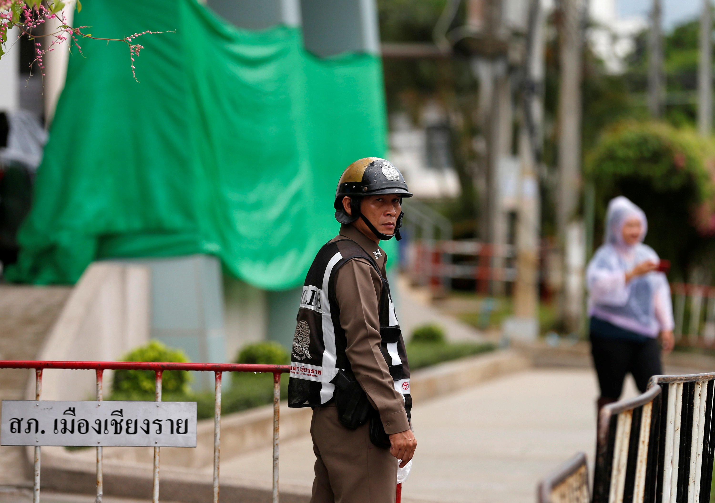 Police keep guard in front of the Chiang Rai hospital where the 12 schoolboys and their soccer coach tapped inside a flooded cave will get treatment, in the northern province of Chiang Rai