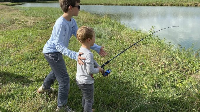 Everett Robbins (L) and James Robbins (R) fishing in a pond in Martin County, N.C.